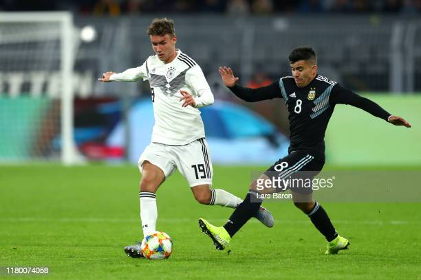Luca Waldschmidt of Germany battles for possession with Marcos Acuna of Argentina during the International Friendly match between Germany and...