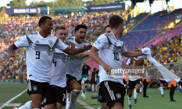 Luca Waldschmidt of Germany celebrates after scoring his team third goal during the 2019 UEFA U21 SemiFinal match between Germany and Romania at...
