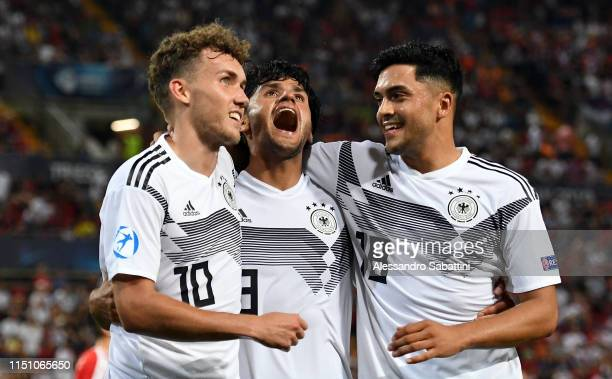 Luca Waldschmidt of Germany celebrates after scoring the 50 goal with team mates during the 2019 UEFA U21 Group B match between Germany and Serbia at...