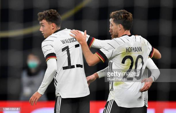 Luca Waldschmidt of Germany celebrates his team's first goal with teammates Philipp Max and Jonas Hofmann during the international friendly match...