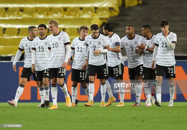 Luca Waldschmidt of Germany celebrates with teammates after scoring his team's third goal during the international friendly match between Germany and...
