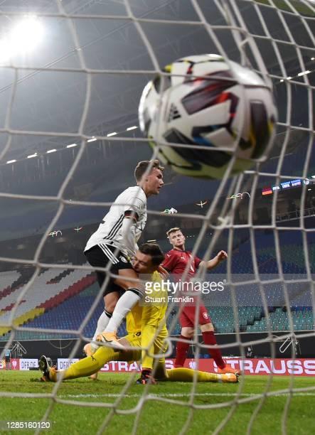 Luca Waldschmidt of Germany hits goalkeeper Jiri Pavlenka of Czech Republic after scoring his team's first goal during the international friendly...