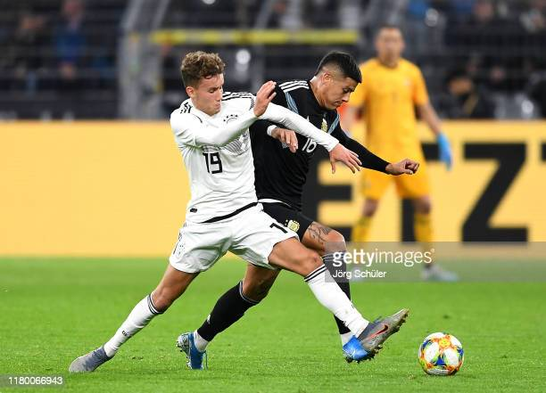 Luca Waldschmidt of Germany is tackled by Marcos Rojo of Argentina during the International Friendly between Germany and Argentina at Signal Iduna...