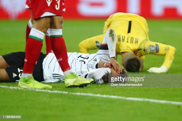 Luca Waldschmidt of Germany reacts after a collision with Aleksandr Gutor of Belarus during the UEFA Euro 2020 Group C Qualifier match between...