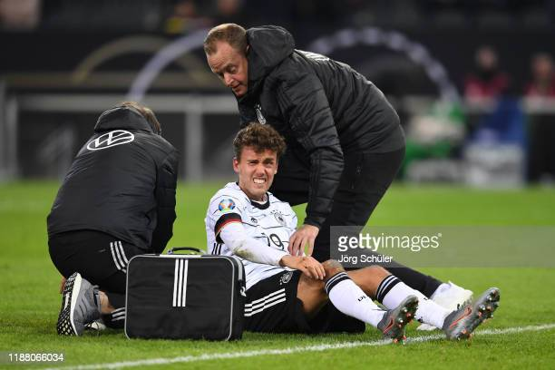 Luca Waldschmidt of Germany receives medical treatment during the UEFA Euro 2020 Group C Qualifier match between Germany and Belarus on November 16...