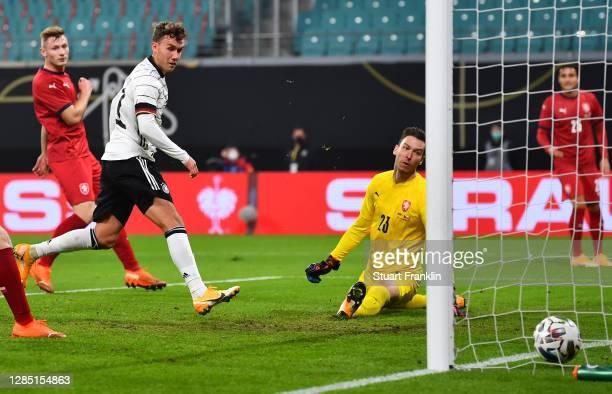 Luca Waldschmidt of Germany scores his team's first goal past goalkeeper Jiri Pavlenka of Czech Republic during the international friendly match...