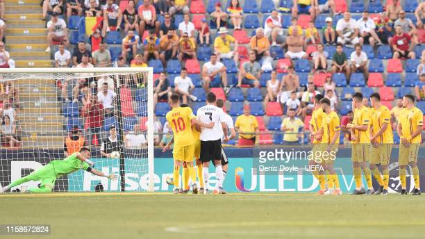 Luca Waldschmidt of Germany scores his team's third goal during the 2019 UEFA U21 SemiFinal match between Germany and Romania at Stadio Renato...
