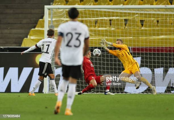 Luca Waldschmidt of Germany scores his team's third goal during the international friendly match between Germany and Turkey at RheinEnergieStadion on...