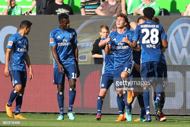 Luca Waldschmidt of Hamburg is celebrated by his team after he scored a goal to make it 13 during the Bundesliga match between VfL Wolfsburg and...