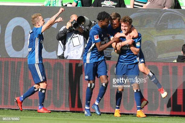 Luca Waldschmidt of Hamburg is celebrated by his team after he scored a goal to make it 1:3 during the Bundesliga match between VfL Wolfsburg and...
