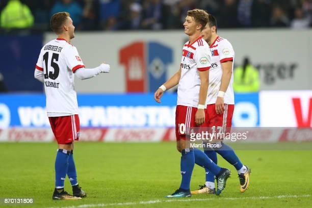 Luca Waldschmidt of Hamburg JannFiete Arp of Hamburg and Filip Kostic of Hamburg celebrate after the Bundesliga match between Hamburger SV and VfB...