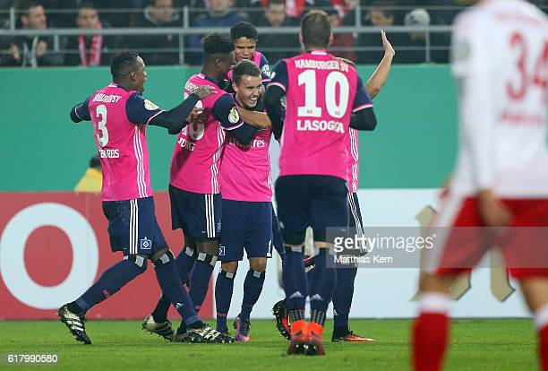 Luca Waldschmidt of Hamburg jubilates with team mates after scoring the fourth goal during the DFB Cup second round match between Hallescher FC and...