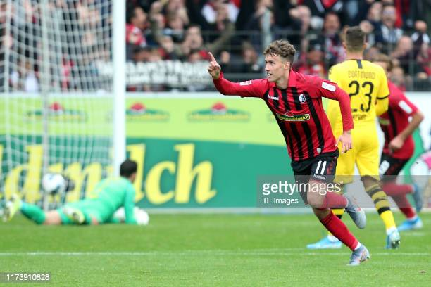 Luca Waldschmidt of SportClub Freiburg celebrates after scoring his team's first goal during the Bundesliga match between SportClub Freiburg and...