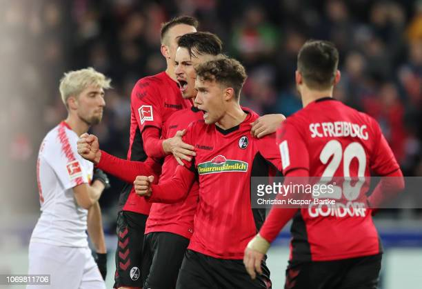 Luca Waldschmift of Freiburg celebrates after scoring his team's second goal during the Bundesliga match between SportClub Freiburg and RB Leipzig at...