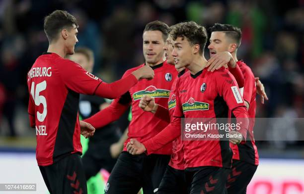Luca Waldschmift of Freiburg celebrates with teammates after scoring his team's first goal during the Bundesliga match between SportClub Freiburg and...