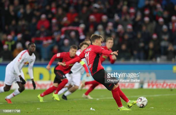 Luca Waldschmift of Freiburg scores his team's second goal during the Bundesliga match between SportClub Freiburg and RB Leipzig at...
