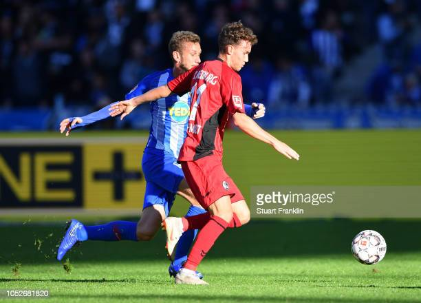 Luca Waldschmift of Freiburg takes Fabian Lustenberger of Hertha BSC during the Bundesliga match between Hertha BSC and SportClub Freiburg at...