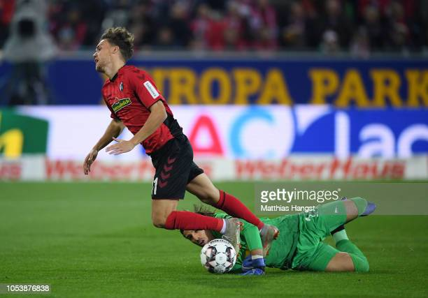 Luca Waldschmift of SC Freiburg is fouled in the penatly area by Yann Sommer of Borussia Monchengladbach during the Bundesliga match between...