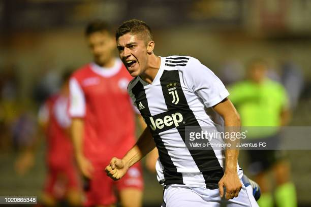 Luca Zanimacchia of Juventus U23 celebrates after scoring the opening goal during the Coppa Italia Serie C match between Juventus U23 and Cuneo at...