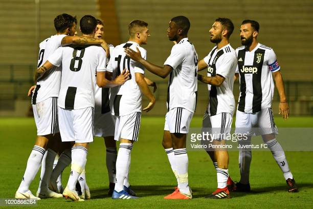 Luca Zanimacchia of Juventus U23 celebrates after scoring the opening goal with team mates during the Coppa Italia Serie C match between Juventus U23...