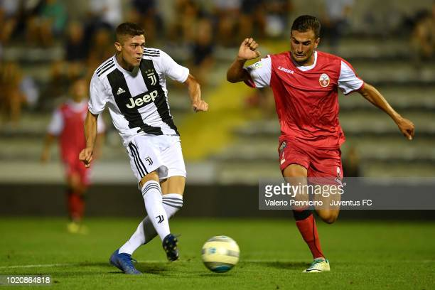 Luca Zanimacchia of Juventus U23 scores the opening goal during the Coppa Italia Serie C match between Juventus U23 and Cuneo at Moccagatta Stadium...