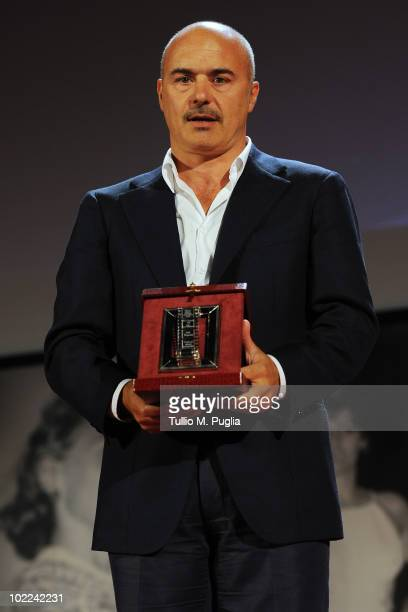 Luca Zingaretti poses with the award for Best Supporting Actor during the Nastri d'Argento ceremony awards on June 19 2010 in Taormina Italy