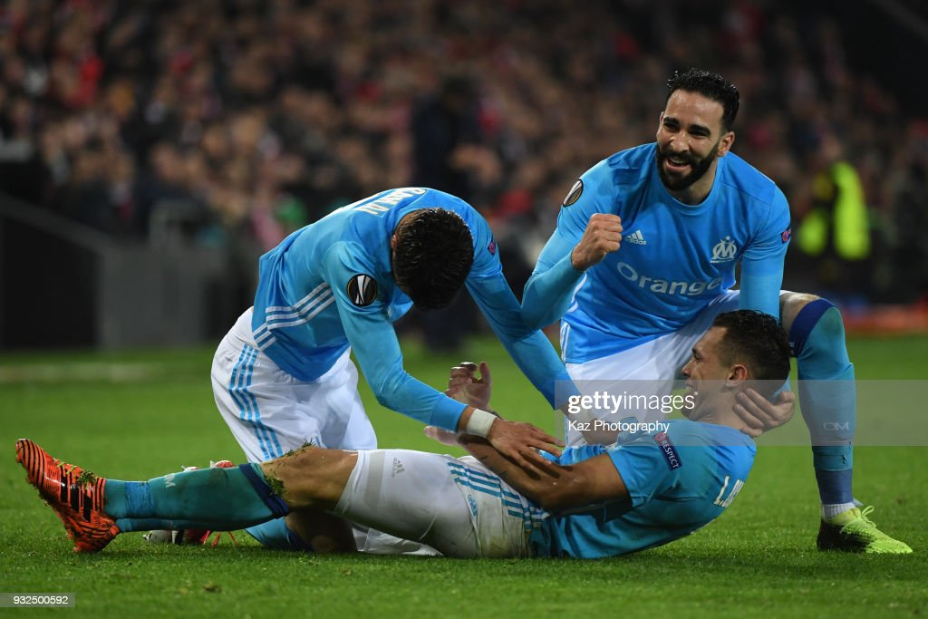 Lucan Ocampos of Marseille celebrates their 2nd goal with his team mate, Kostas Mitroglou of Marseille during UEFA Europa League Round of 16 match between Athletic Bilbao and Marseille at the San Mames Stadium on March 15, 2018 in Bilbao, Spain.