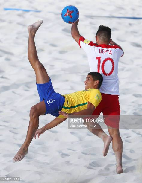 Lucao of Brazil scores his team's first goal past Dominik Depta of Poland during the FIFA Beach Soccer World Cup Bahamas 2017 group D match between...