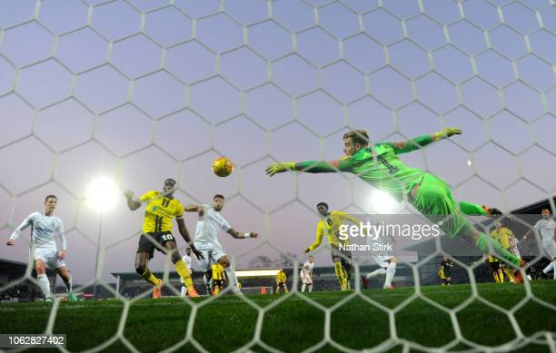 Lucas Akins and Bradley Collins of Burton Albion watch Jordan Willis of Coventry's own goal go into the net during the Sky Bet League One match...