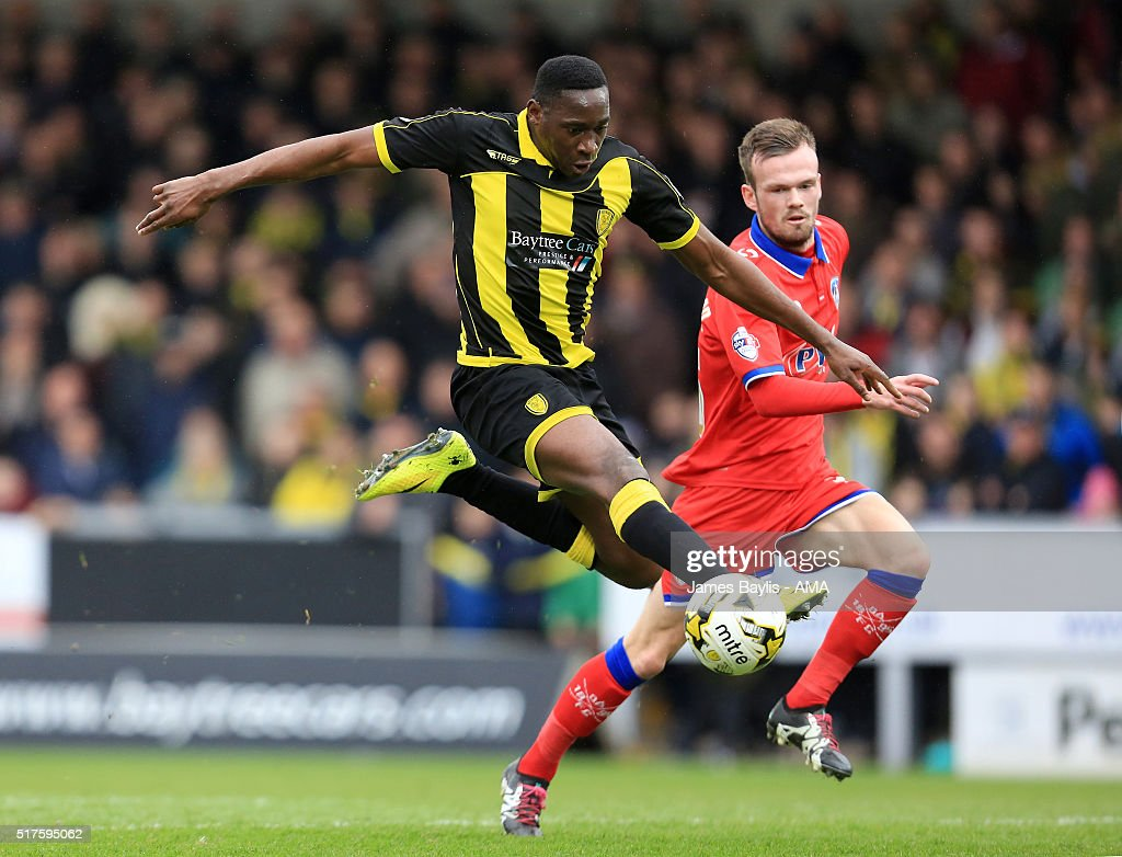 Lucas Akins of Burton Albion and Cameron Dummigan of Oldham Athletic during the Sky Bet League One match between Burton Albion and Oldham Athletic at Pirelli Stadium on March 26, 2016 in Burton-upon-Trent, England.
