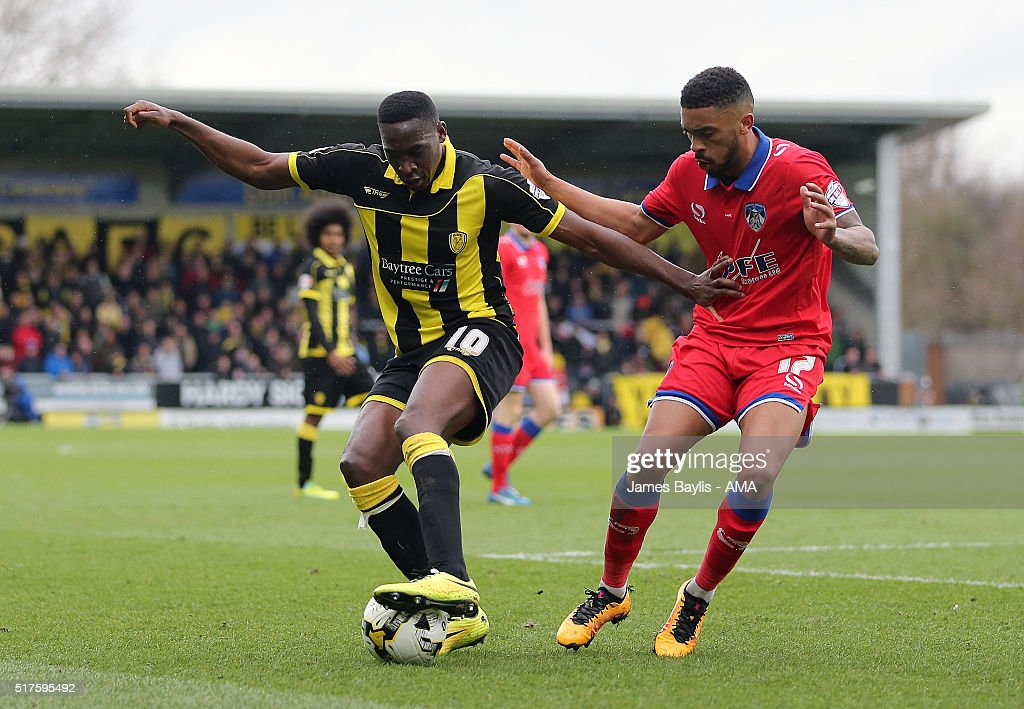 Lucas Akins of Burton Albion and Tareiq Holmes-Dennis of Oldham Athletic compete for the ball during the Sky Bet League One match between Burton Albion and Oldham Athletic at Pirelli Stadium on March 26, 2016 in Burton-upon-Trent, England.