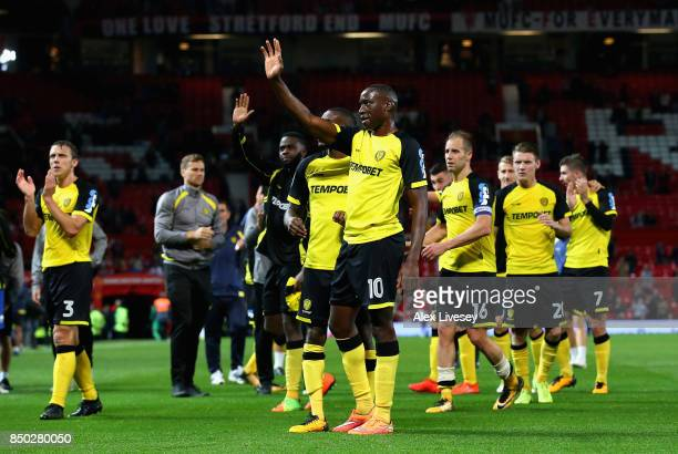 Lucas Akins of Burton Albion and team mates show appreciation to their fans during the Carabao Cup Third Round match between Manchester United and...