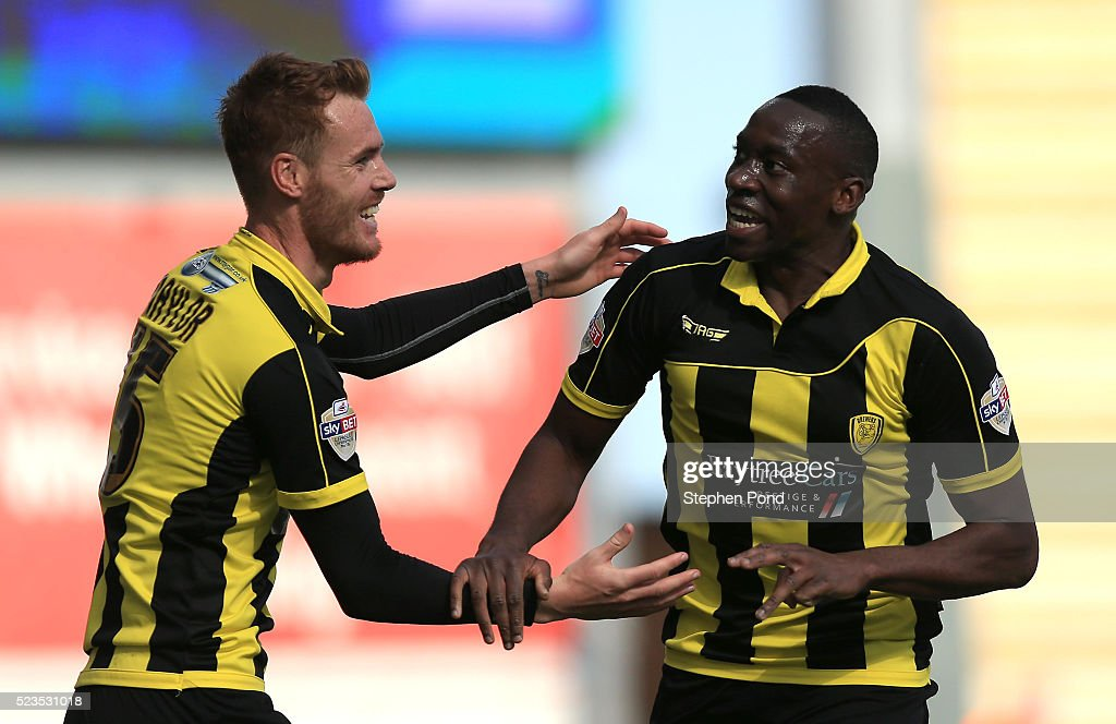 Lucas Akins of Burton Albion celebrates his third goal to complete a hat trick with Tom Naylor during the Sky Bet League One match between Colchester United and Burton Albion at Colchester Community Stadium on April 23, 2016 in Colchester, England.