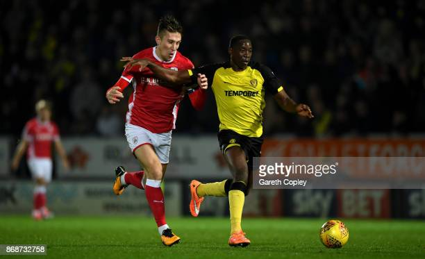 Lucas Akins of Burton holds off Angus MacDonald of Barnsley during the Sky Bet Championship match between Burton Albion and Barnsley at Pirelli...