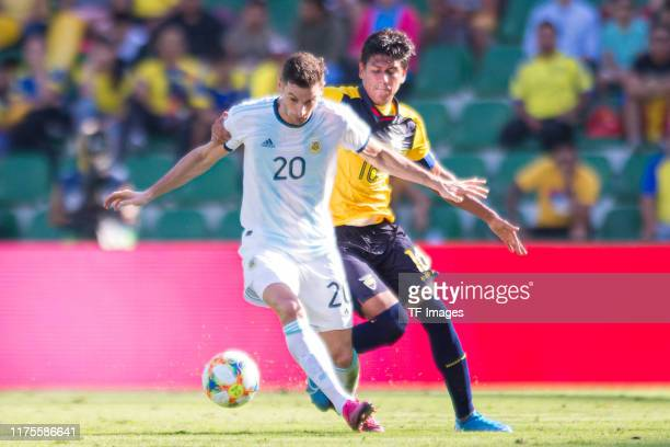 Lucas Alario of Argentina and Xavier Arreaga of Ecuador battle for the ball during the UEFA Euro 2020 qualifier between Ecuador and Argentina on...