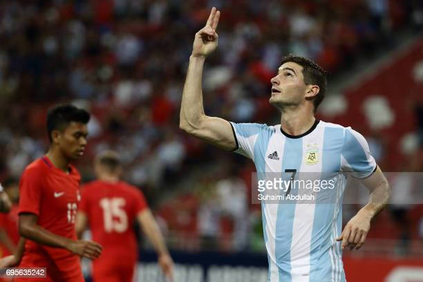 Lucas Alario of Argentina reacts after scoring a goal during the International Test match between Argentina and Singapore at National Stadium on June...