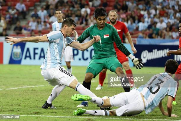Lucas Alario of Argentina tries to shoot past Izwan Mahbud of Singapore during the International Test match between Argentina and Singapore at...