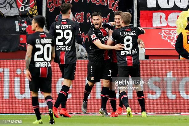 Lucas Alario of Bayer 04 Leverkusen celebrates scoring his sides third goal with his team during the Bundesliga match between Bayer 04 Leverkusen and...