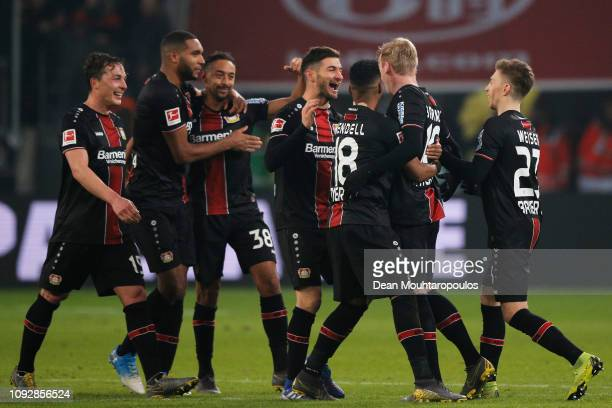Lucas Alario of Bayer 04 Leverkusen celebrates scoring his teams third goal of the game during the Bundesliga match between Bayer 04 Leverkusen and...