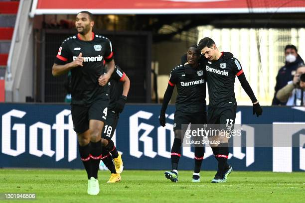 Lucas Alario of Bayer 04 Leverkusen celebrates with team mate Moussa Diaby after scoring their side's first goal during the Bundesliga match between...