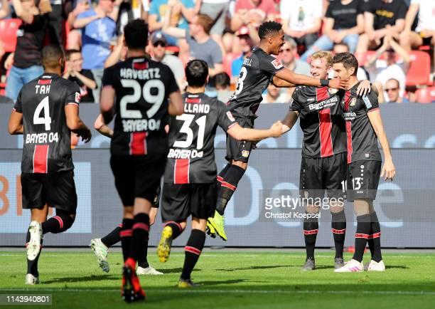 Lucas Alario of Bayer 04 Leverkusen celebrates with teammates after scoring his team's first goal during the Bundesliga match between Bayer 04...