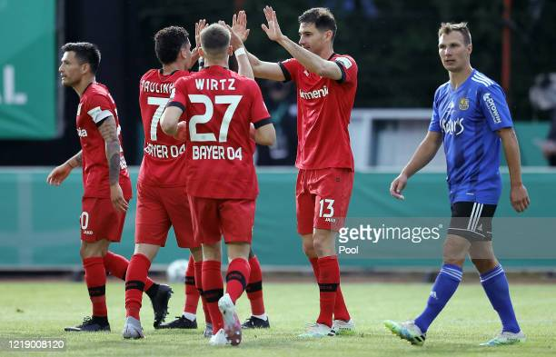 Lucas Alario of Bayer 04 Leverkusen celebrates with teammates after scoring his team's second goal during the DFB Cup semifinal match between 1. FC...