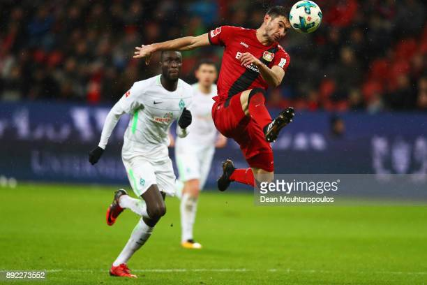 Lucas Alario of Bayer 04 Leverkusen gets past the tackle from Lamine Sane during the Bundesliga match between Bayer 04 Leverkusen and SV Werder...