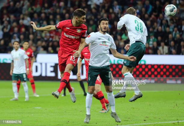 Lucas Alario of Bayer 04 Leverkusen heads the ball towards the goal leading to an own goal by Omer Toprak of SV Werder Bremen for Bayer Leverkusen's...