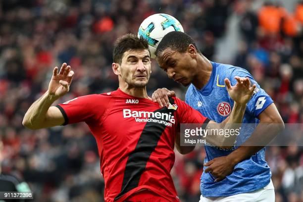 Lucas Alario of Bayer Leverkusen and Abdou Diallo of FSV Mainz 05 battle for the ball during the Bundesliga match between Bayer 04 Leverkusen and 1...