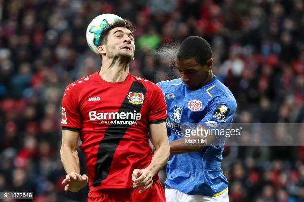 Lucas Alario of Bayer Leverkusen and Abdou Diallo of FSV Mainz 05 battle for the ball during the Bundesliga match between Bayer 04 Leverkusen and 1...