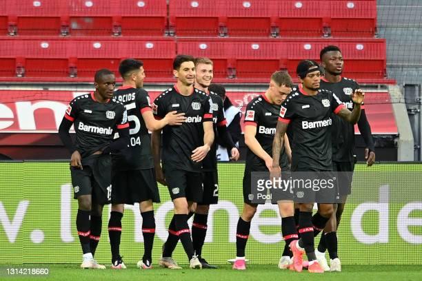 Lucas Alario of Bayer Leverkusen celebrates with teammates after scoring their team's second goal during the Bundesliga match between Bayer 04...