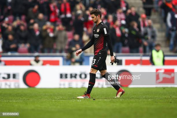 Lucas Alario of Bayer Leverkusen walks off the pitch after receiving a red card from referee during the Bundesliga match between 1 FC Koeln and Bayer...