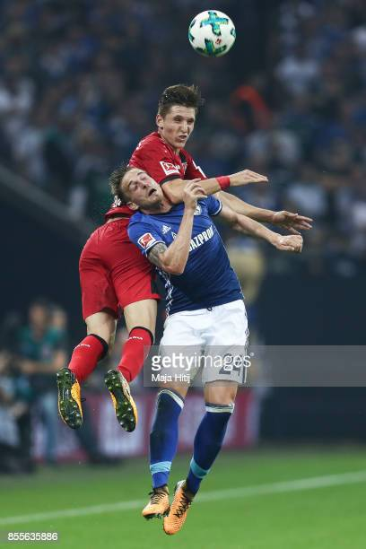Lucas Alario of Leverkusen and Bastian Oczipka of Schalke battle for the ball during the Bundesliga match between FC Schalke 04 and Bayer 04...