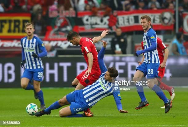 Lucas Alario of Leverkusen and Niklas Stark of Hertha battle for the ball during the Bundesliga match between Bayer 04 Leverkusen and Hertha BSC at...
